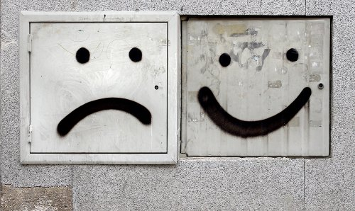 happy and sad graffiti faces